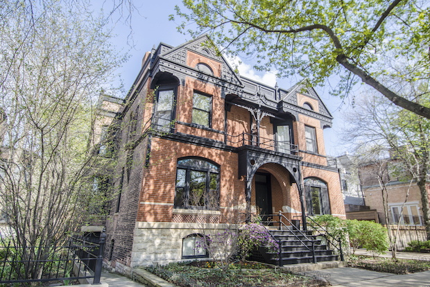 "A three-bedroom brick rowhome built in Lincoln Park in 1885 is on the market for $1,350,000. Located at 2319 N. Cleveland Ave., the home was overhauled in 1993 ""while preserving its vintage character,"" according to Coldwell Banker's Jennifer Ames."