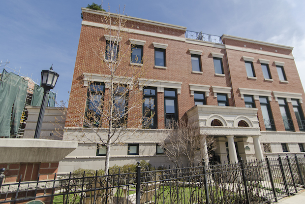 "A three-bedroom Lincoln Park townhouse with a ""penthouse"" family room is on the market in The Pointe development for $1.25 million."