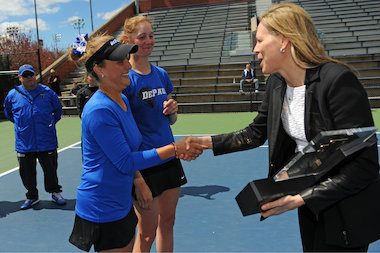 DePaul junior Patricia Fargas was named the Most Oustanding Player of the 2014 Big East Women's Tennis Tournament. Here, Fargas receives the award from Big East Commissioner Val Ackerman. The Blue Demons face Notre Dame on Friday in Evanston in the first round of the NCAA tournament.