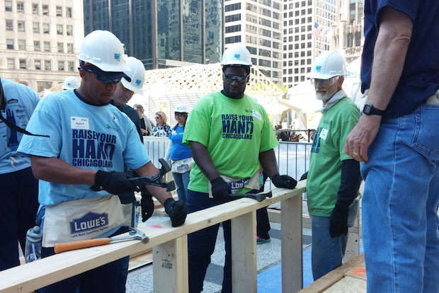 Habitat for Humanity, which constructs houses for low-income families to buy through zero-interest mortgages, will be in Pioneer Court plaza, building homes for people in West Pullman and the Chicagoland area through June 1 as part of its Raise Your Hand Chicagoland event.
