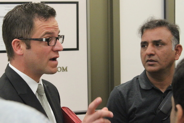 First Ward Ald. Joe Moreno talks with Armitage Food manager Nazeer Chaudhry after Tuesday's hearing.