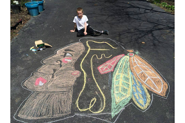 Megan Doherty Jamen's 8-year-old son, Colin, drew this Blackhawks logo with chalk on Saturday. Game 3 of the Hawks' series against the Wild is at 8 p.m. Tuesday in Minnesota.