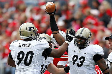 Kawann Short (93) is congratulated by Bruce Gaston (90), both of the Purdue Boilermakers, after recovering a fumble during the first quarter against the Ohio State Buckeyes on Oct. 20, 2012, at Ohio Stadium in Columbus, Ohio.