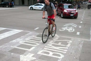 "The West Town Chamber of Commerce is launching a ""bike-friendly"" business district next month."