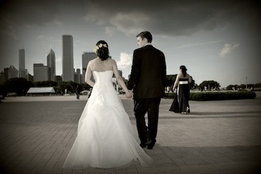 A newly married couple walks through Grant Park.