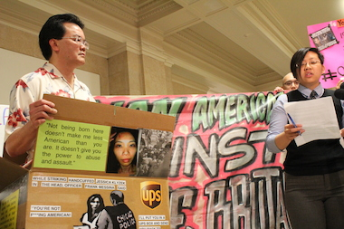 Attorney Nebula Li (r.) delivers remarks at a City Hall protest where Asian-American groups demanded justice for the victim of an alleged police abuse case.