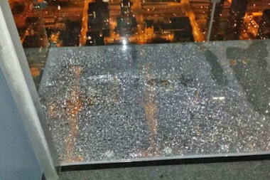 "NBC5 said tourist Alejandro Garibay had a ""crazy feeling and experience"" when the glass beneath him on the Willis Tower Ledge cracked. Officials said it was only the cosmetic top layer, not structural."