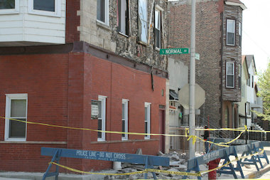 The owner of a building whose facade came crashing to the ground late Sunday morning said he had been trying to get city approval for months to fix the facade of the building at 28th and Normal.