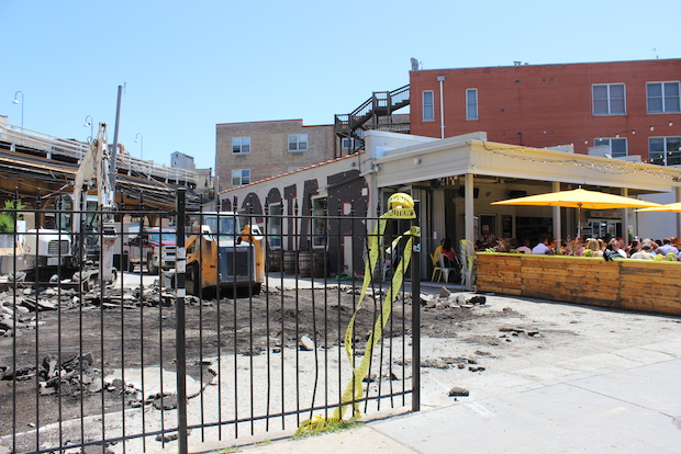 The next door parking lot that will eventually be home to more patio space appeared to have been torn up Friday.