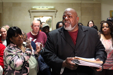 Jitu Brown of the Kenwood Oakland Community Organization rallies protesters outside Mayor Rahm Emanuel's office Wednesday.
