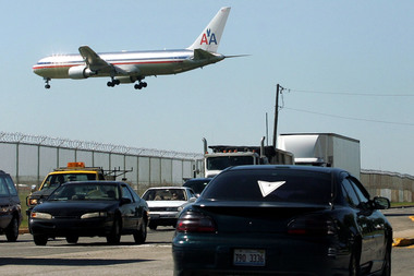A jet lands at O'Hare Airport.