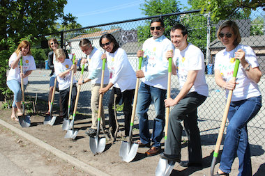 Organizers of the groundbreaking for Ravenswood's new outdoor campus were hard-pressed to find a patch of dirt for the shoveling ceremony. They settled on the narrow strip of green that divides the school's asphalt playground from its asphalt parking lot.