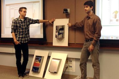 Columbia College seniors Korey Brisendine (l.) and Sam Shapiro present their prototypes.
