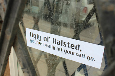 The stickers have been applied to empty storefronts up and down Halsted Streets.