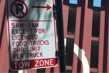 A sign at 828 N. Larrabee indicates where food trucks can park and for how long they can stay in the spots. The signs were removed, causing confusion among food trucks. The city said the stand was being moved south of Chicago Avenue where vehicle traffic is not as heavy.