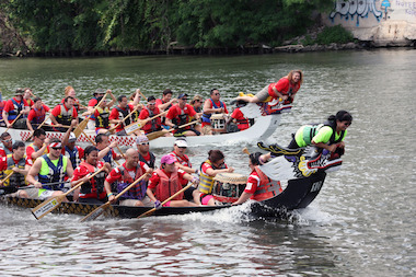 The 14th annual edition of the Dragon Boat Race for Literacy was held in the Chicago River off of Ping Tom Memorial Park in Chinatown on June 28, 2014. CDW Dragon PAC, in the black boat, beat the team from Performance Health in this race.