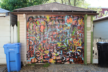 The latest trend in Pullman alley galleries is to add the hieroglyphics-inspired folk art of local artist Ian Lantz to garage doors.