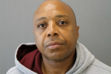 Andre Davis, 52, is charged with the October 2013 murder of 19-year-old Jamal Harmon, police said.