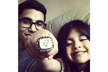 Arturo Aupont and his 5-year-old niece, Natalia, hold up the boys soccer state championship ring that he won with Washington High School. Aupont had the game-winning goal in a double-overtime victory over St. Ignatius College Prep.