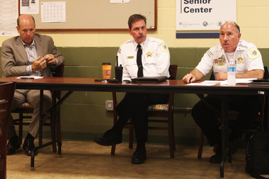 Ald. Harry Osterman (from left), Foster Police District Cmdr. Kevin Duffin and Rogers Park Cmdr. Thomas Waldera talk Monday about neighborhood crime with Edgewater residents.