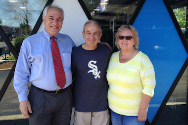 Residents next door to Superdawg in Norwood Park have developed a food-friendly relationship with the restaurant over the last few decades. Joe and Sandi Colello have lived next to the iconic restaurant since 1988. Here they're shown with Scott Berman (l.), whose parents, Maurie and Flaurie Berman, founded the restaurant on May 8, 1948.
