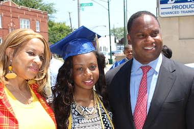 Walter Gresham Elementary School Principal Diedrus Brown (left) and Jonathan Jackson (right), a Chicago State University professor, congratulate Demaria Dickerson, 13, who graduated from Gresham on June 9, 2014.