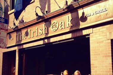 Police said a woman was pushed into a men's bathroom stall and sexually assaulted inside The Irish Oak.