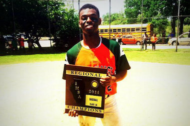 James Davison poses with the regional championship trophy after his Morgan Park High School baseball team claimed the title. Davison was drafted by the White Sox but has decided to go to junior college in Texas instead.