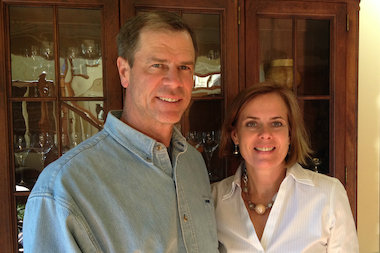 Mary Cook-Gallagher, of Sauganash, is founder and owner of Mary Cook Associates, Inc., an interior design firm with 26 employees. Here she poses with her husband, Chicago Fire Department Capt. Gerald Gallagher, at their home.