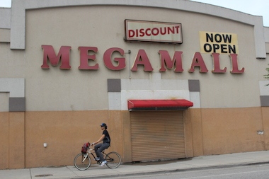 The indoor flea market is up for sale, but will the neighborhood see a grocery store in its place?