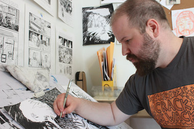 "Mike Freiheit at work on ""Monkey Chef"" in his Albany Park studio."