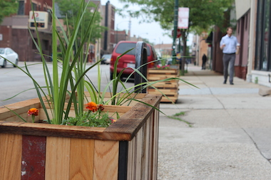 A secret group is putting flower planters along busy Morgan Street.