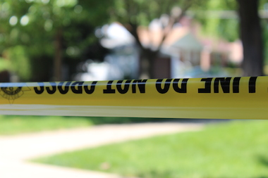 Two men yelled gang slogans before fatally shooting the teen Sunday morning, police said.