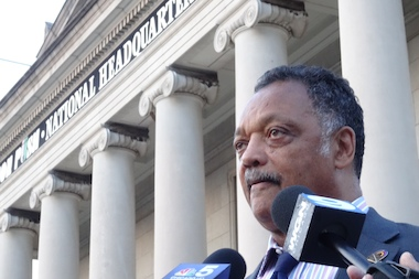 Rev. Jesse Jackson speaks to reporters outside the Rainbow PUSH Coalition headquarters in Kenwood.