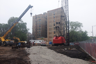 Work has begun on Col. Jennifer Pritzker's controversial 250-car parking garage on Sheridan Road.