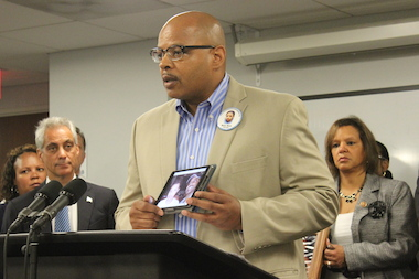 "Ronald Holt, father of a 16-year-old son killed in a CTA bus shooting in 2007, said universal background checks for those seeking to buy guns are ""critical."""