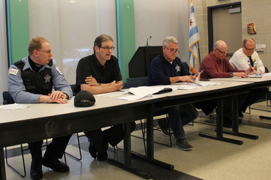 Sgt. Jason Clark (second from left) and Cmdr. Elias Voulgaris (far right) talked Lakeview crime stats Wednesday night.