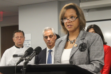 U.S. Rep. Robin Kelly was backed by t he Rev. Michael Pfleger and Mayor Rahm Emanuel   in her call for new gun laws.