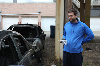 Elliot Stevens, 24, eyes the damage to his car.
