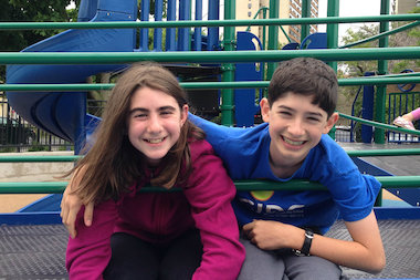 Ariana Handelman (l.) and Marc Luban pose for a photo at Lane Beach Park. Instead of having a lavish party for the respective Bat and Bar Mitzvahs, Handelman and Luban are raising money for a new playground at Bright Star Church in Bronzeville.