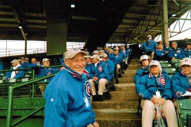 "Bruce Bohrer, a former Wrigley Field usher, stands in one of the many sections that workers were assigned to throughout the season. He's written a book about his memories of having ""the best seat in the house"" at The Friendly Confines."