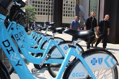 Divvy bikes lined up at a station at Daley Plaza.