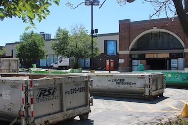 Dumpsters and construction equipment occupy the former Dominick's parking lot at 6009 N. Broadway that's slated to open as a Whole Foods store next June.