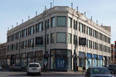 The former Goldblatt's building in Logan Square will soon include several new retail outlets in a push to revitalize the triangle corner of Milwaukee, Diversey and Kimball avenues, according to the building's property managers.