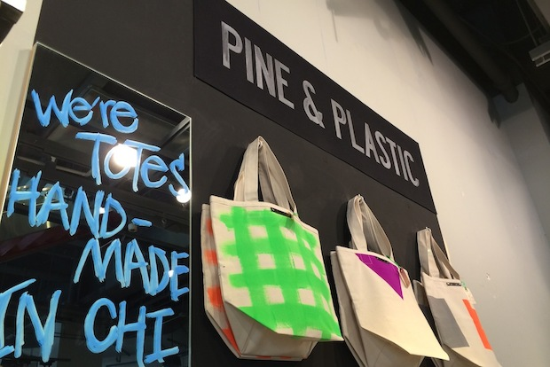 The Edgewater couple behind Pine & Plastic , a brand of handcrafted totes typically only available online, are selling their artsy wares Downtown as one of the merchants at  Lollapalooza's pop-up store.