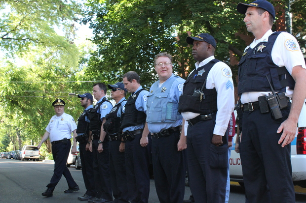 Town Hall District officers held a public roll call after two armed robberies last Friday.