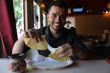 Ambrocio Gonzalez, chef and co-owner at Las Quecas, gets ready to chow down on a quesadilla at his restaurant at 2500 S. Christiana Ave.