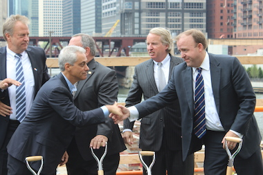 Mayor Rahm Emanuel shakes hands with Ald. Brendan Reilly after Friday's groundbreaking, with Mike Stotz (l.) and Chris Kennedy in the background.