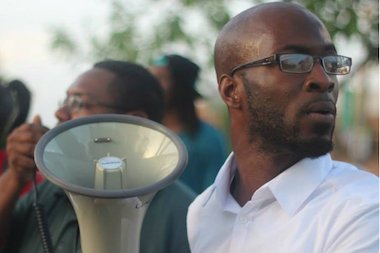"Anti-violence activist Jedidiah Brown, 27, leads a ""Village Take Back"" march in June through Altgeld Gardens."