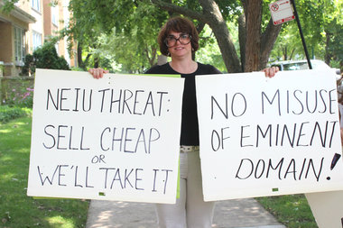 Tania Beil-Mainz was among those picketing outside the home of NEIU President Sharon Hahs, protesting the university's plan to exercise eminent domain to snap up properties on Bryn Mawr — including a building owned by Beil-Mainz' parents.